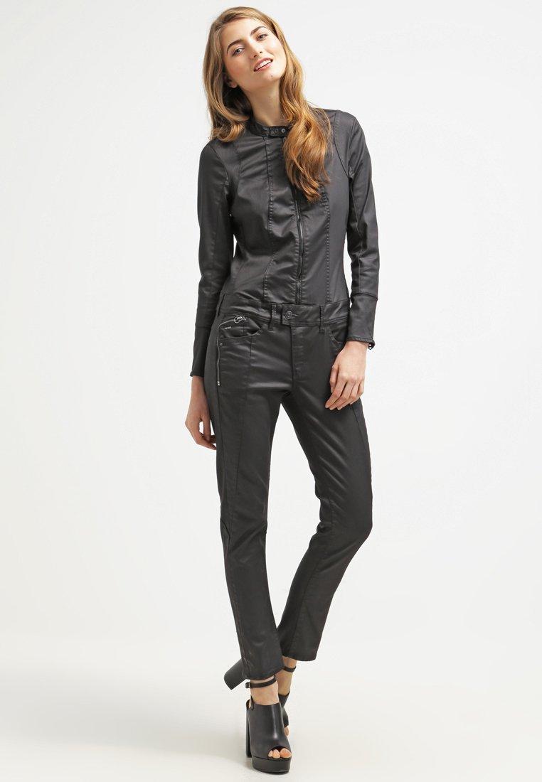 g star lynn jet suit combinaison distro black combinaison g star zalando. Black Bedroom Furniture Sets. Home Design Ideas