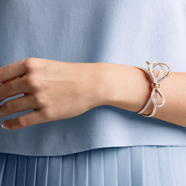 Manchette Lifelong Bow Swarovski blanc combinaison de métaux plaqués